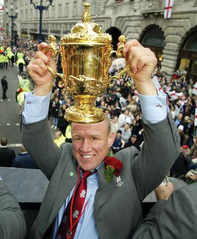 Neil Back holding trophy